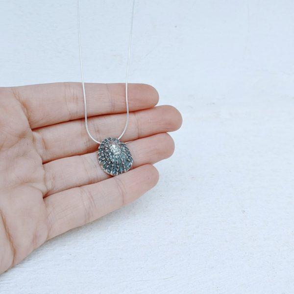 colgante de plata concha